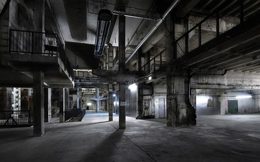Industrial concrete and metal interior of Kraftwerk exhibition space in Berlin