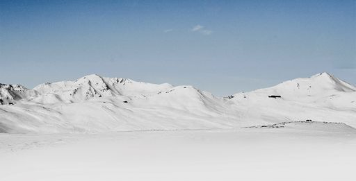 beautiful bright white jagged mountain landscape against a clear blue sky